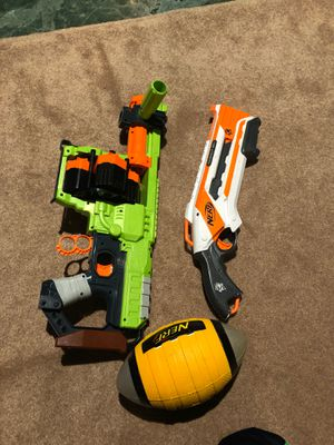 Nerf guns dominated rough cut and a football for Sale in Mukilteo, WA