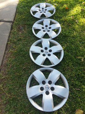 Nissan hubcaps for Sale in Riverside, CA