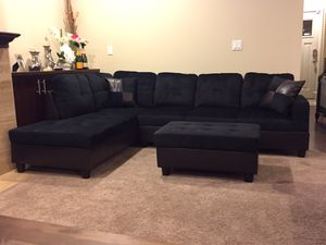 Black microfiber sectional couch and ottoman for Sale in Seattle, WA
