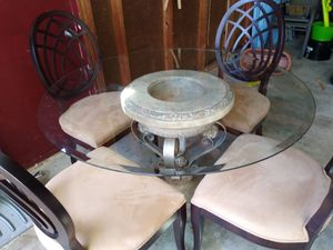Round glass dining table, diameter-4 ft. Plus four deluxe upholstered wooden chairs. for Sale in Gladwin, MI