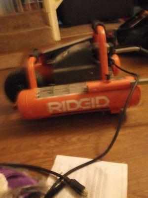 Ridgid mini wheel barrow air compressor for Sale in Columbus, OH