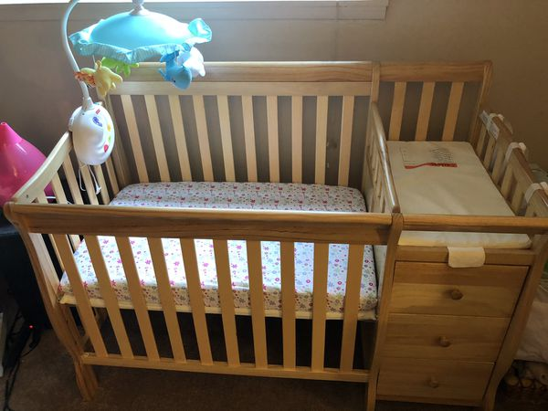 Mini crib w/ attached changing table. Mobile. Diaper station.