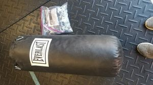 Punching bag with chain and new hand wrap for Sale in Alexandria, VA