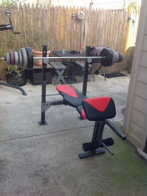 Workout bench , 20 lbs 6 ft bench bar ,100 lbs of weights for Sale in Queens, NY