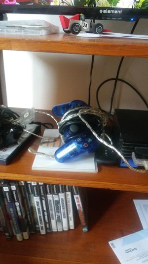 Ps2 with two controllers and games for Sale in Cleveland, OH