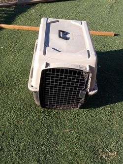 GREAT CHOICE KENNEL MEDIUM Sized Asking $50 Must Pick Up NEW quite big also has a carrying handle as well for Sale in Phoenix,  AZ