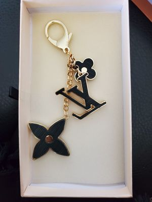 Louie charm with box for Sale in Garland, TX