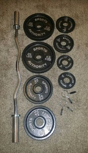 """Olympic 2"""" weights and curl bar. 2x25lbs, 2x10lbs, 2x5lbs, 2x2.5lbs.2 weight lock clips. for Sale in Deerfield Beach, FL"""