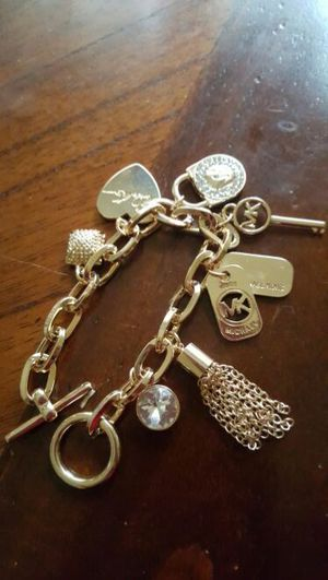 Michael Kors charm bracelet for Sale in Severn, MD