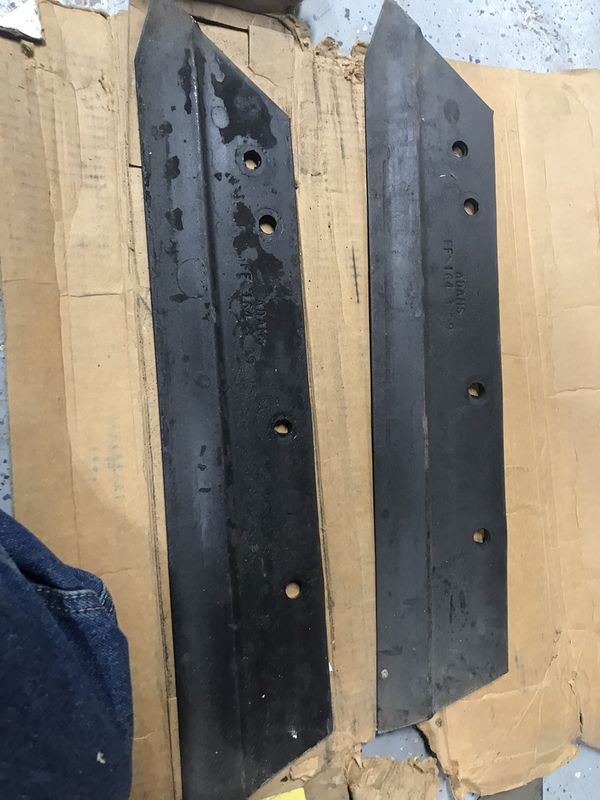 2 Ford 164 Plow Shares $8 for both You Must Pickup