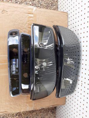 Head lights gmc sierra 99-06 for Sale in Houston, TX