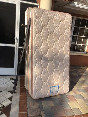Twins size bed mattress and box springs frame for Sale in Fort Myers, FL
