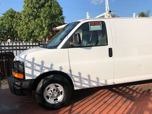 2014 Chevy Express, Rebuilt title, low miles, v6 4.3 litres gasoline automatic transmission, excellent conditions, 786 ::356 :::35 :::30 Raul for Sale in Miami, FL