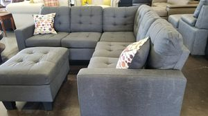 A small bluish grey sectional with a matching ottoman for Sale in Foothill Farms, CA