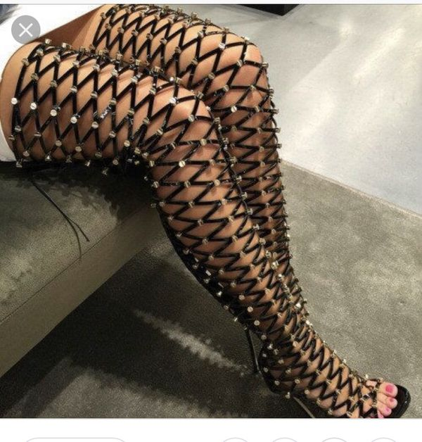 Thigh high black and gold studded sandal heels