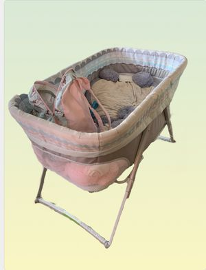 Fold up rocking bassinet and diaper changing table with storage drawer for Sale in Virginia Beach, VA