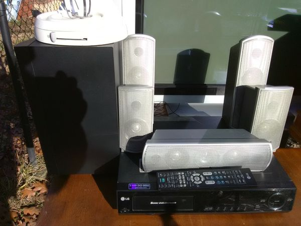 500 Watts LG surround sound receiver with built-in 5 discs DVD player with remote control plus speakers