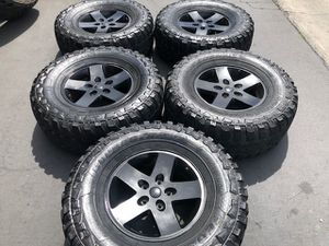 "(5) 17"" Black Jeep Wheels + 35x12.5R17 tires - $525 for Sale in Santa Ana, CA"