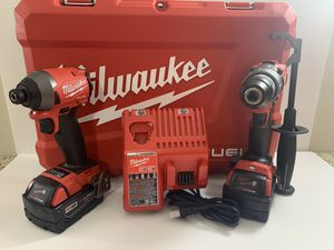 Set Milwaukee FUEL with impact drill,hammer drill,charger,hard case and battery's (5.0)BRAND NEW for Sale in Dallas, TX