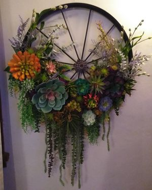 Handmade silk succulents metal wheel for Sale in Greensburg, PA