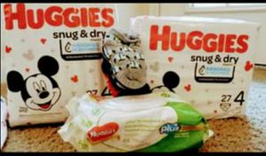 (2) packs of Huggies diapers; size 6-8 month outfit and a pack of wipes! for Sale in Austin, TX