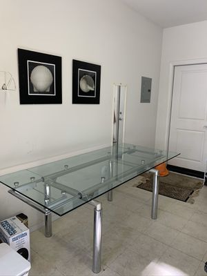 Beautiful modern glass top chrome base extendable dinning table for Sale in Irvine, CA