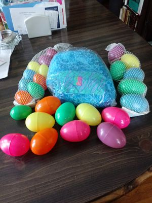 Easter grass blue and plastic eggs for Sale in Columbus, OH