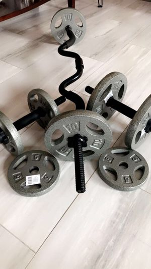 60 lb adjustable dumbbell and standard curl bar. for Sale in Katy, TX