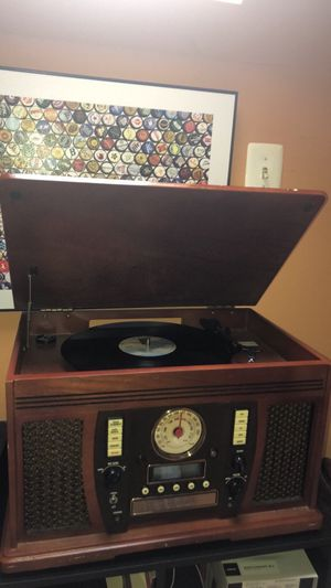 Record Player with CD player, Aux cord and radio along with 30+ classic Records for Sale in Arlington, VA