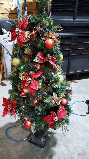Light up trees they're beautiful about 4 and a 1/2 feet tall for Sale in Minot, ND
