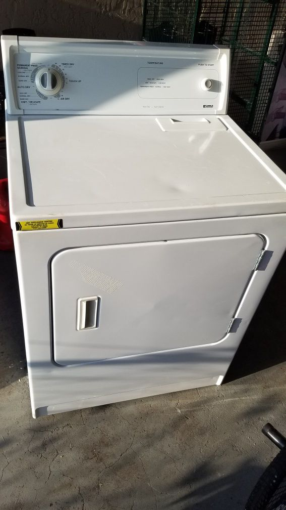 kenmore dryer almost like new very little scratches and a large capacity $90