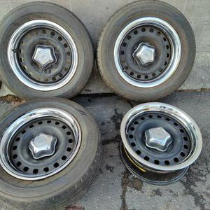 original steel Ford 16 inch rims with caps and trim rings. 5 on 4.5 for Sale in Montebello, CA