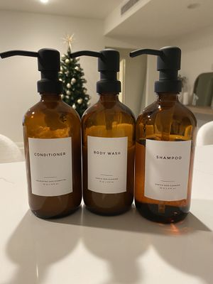 Beautiful amber glass labeled bottles shampoo, conditioner, body wash for Sale in Los Angeles, CA