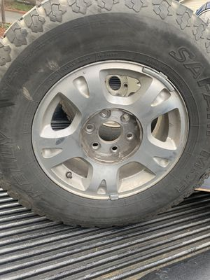 Silverado rims with snow tiers and center Caps for Sale in Vancouver, WA