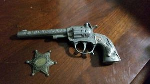 Collectable toy gun and sheriff badge for Sale in Cleveland, OH