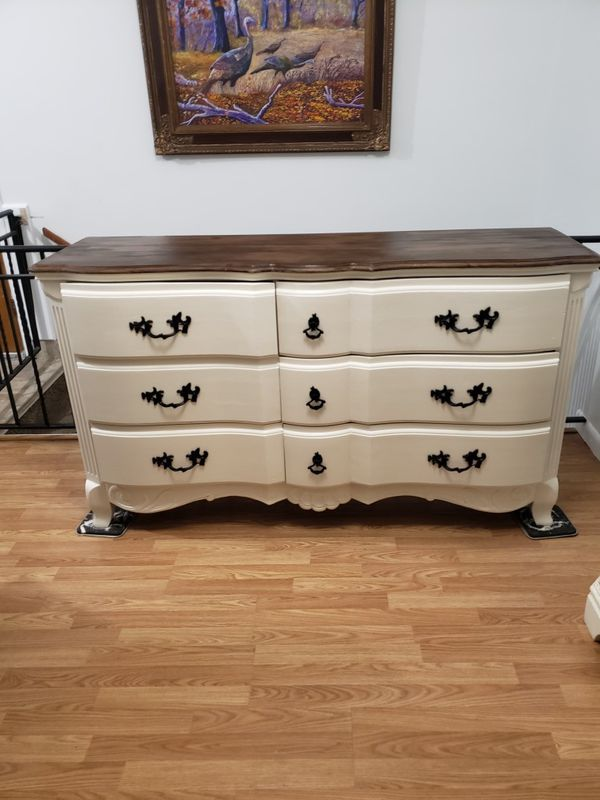 """Solid wood dresser with 6 drawers .wide 64"""" deep 18"""" tall 35""""."""