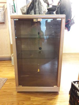 TV stand glass and wood with two shelves of glass doors open out also CD player VHS you can put inside for Sale in Las Vegas, NV