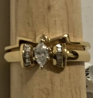 14 karat yellow gold diamond marquise ring with baguette accents and with a bowtie look for Sale in Sun City, AZ