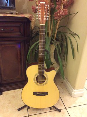 Fever 12 string electric acoustic guitar with built in tuner come with soft case strap and cable for Sale in Lynwood, CA
