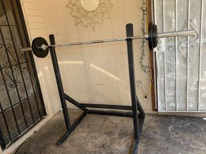 320$ olimpic bar and rack and 80pounds in weights for Sale in Phoenix, AZ