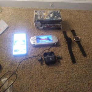 PlayStation PsP With Charger. Moto Fast 9. FitBit Versa 2. Garmin 24kt Gld Rim Watch.5 Psp Games. Skull Head Wireless Earbuds for Sale in Indianapolis, IN