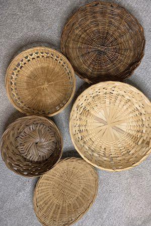 1. set of five wicker plate baskets for wall decor for Sale in Seattle, WA