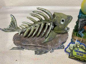 The swimming dead aquarium fish tank ornament glow in the dark new for Sale in Hesperia, CA