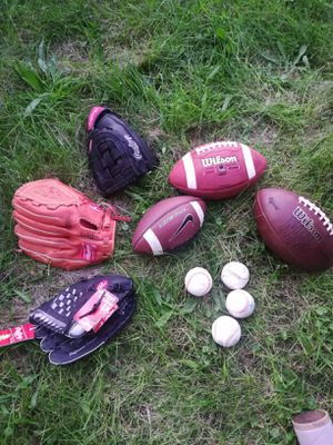 Football balls and baseball gloves for Sale in Warren, MI