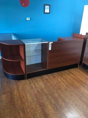 Retail counter w/cherry finish, adjustable tempered glass shelves & sliding doors for Sale in Miami, FL