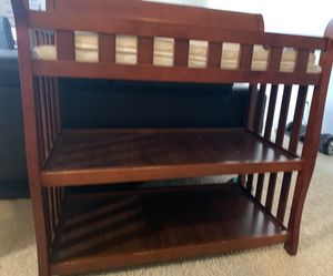 Delta Children Eclipse Changing Table with Changing Pad, Black Cherry, in prefect condition for Sale in Lancaster, CA