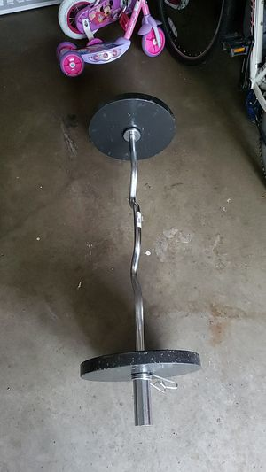 Olympic curl bar with (2) 25lb plates for Sale in Oswego, IL