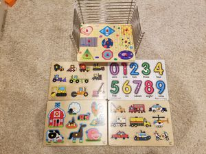 Melissa and Doug puzzle rack with 5 puzzles for Sale in Renton, WA