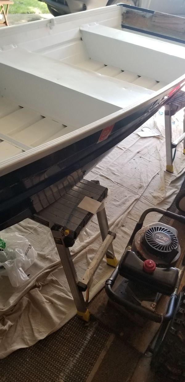 2006 John Boat. 10 Foot. 40 Hours sanding to bare aluminum. Primed 2 times, 3 coats of white amd Navy Blue