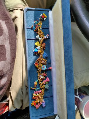 37 charm 24 karat gold Disney bracelet for Sale in Charlotte, NC